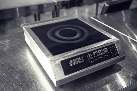 Induction cooker in restaurant kitchen