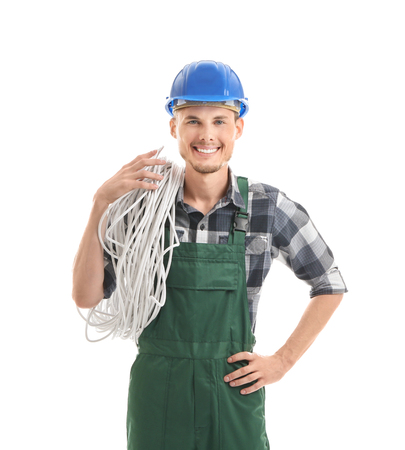 Young male electrician on white background Stock Photo