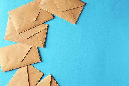Mail envelopes on color background
