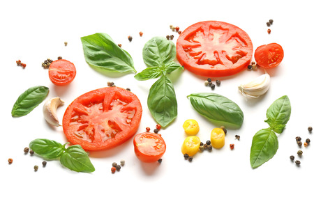 Composition with spices and tomatoes on white background 免版税图像