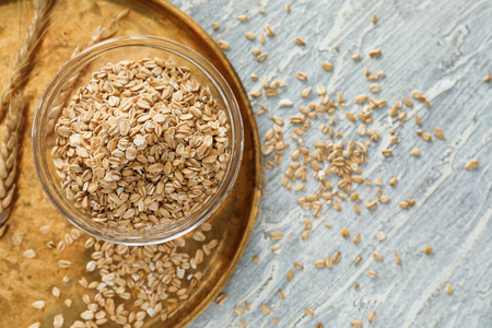 Bowl with raw oatmeal on wooden background Stok Fotoğraf
