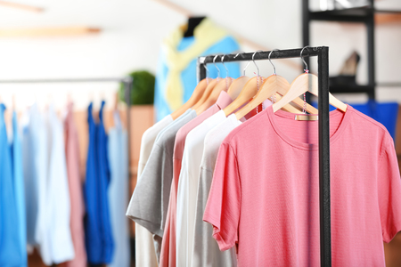 Rack with female t-shirts in clothing shop