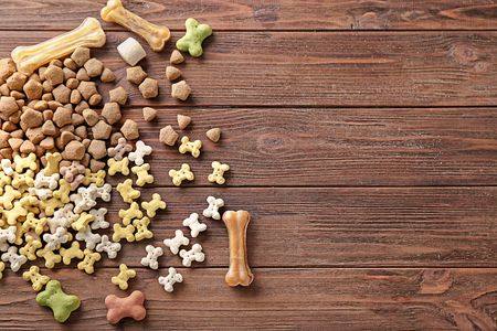 Pile of pet food on wooden background
