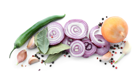 Composition with red onion, garlic and fresh spices on white background