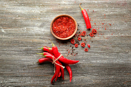 Composition with chili pepper on wooden background