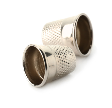 Metal thimbles on white background