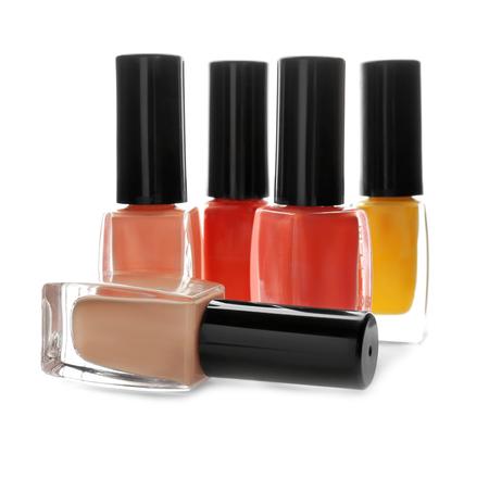 Bottles of colorful nail polish on white background