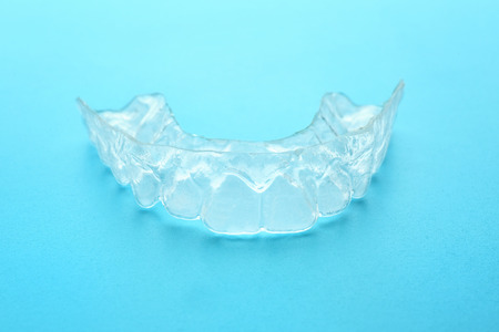 Occlusal splint on color background