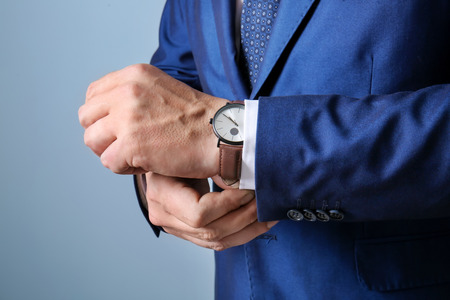 Businessman in elegant suit on color background, closeup Stock Photo