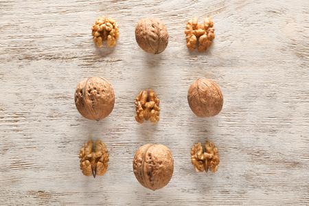 Tasty walnuts on wooden background