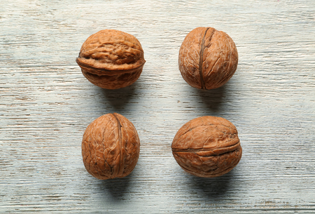 Unpeeled walnuts on wooden background 写真素材