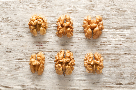 Tasty walnuts on wooden background