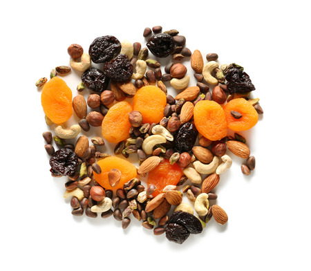 Different nuts with dried fruits on white background