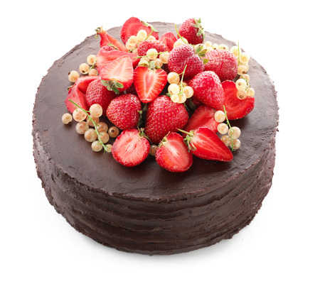 Tasty chocolate cake with strawberries and currants on white background