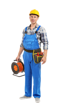 Electrician with extension cord reel and tools on white background