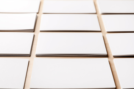 Blank business cards on wooden background, closeup