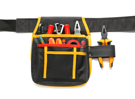 Bag with different electricians tools on white background Stock Photo