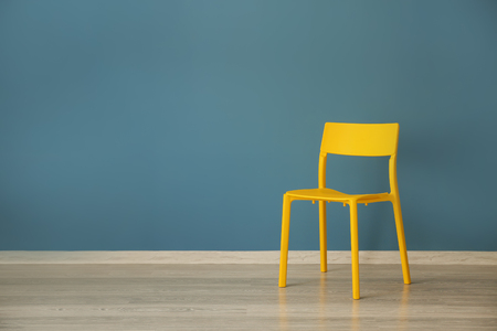 Yellow chair near color wall