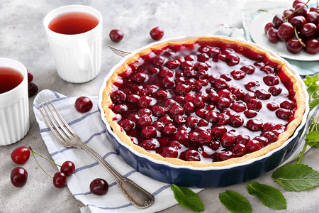 Tasty cherry pie on table