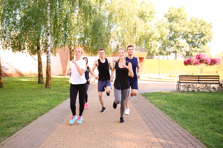 Group of young sporty people running outdoors