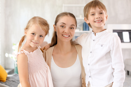 Cute little kids with their mother at home Stockfoto