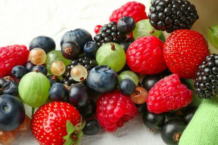 Delicious ripe berries on table, closeup Archivio Fotografico