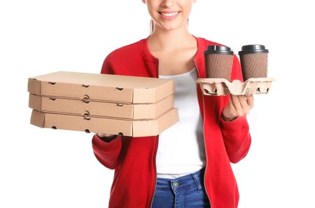 Young woman with pizza boxes and cups of coffee on white background. Food delivery service Imagens