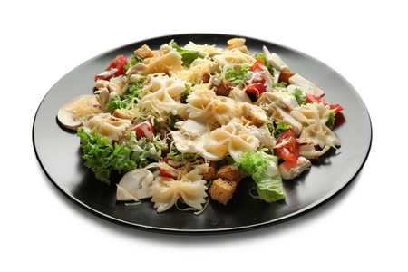 Tasty Caesar salad with pasta on white background