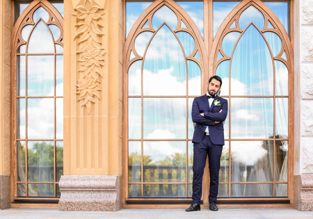 Handsome young groom in elegant suit outdoors Stock Photo