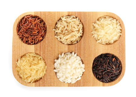 Wooden holder with different types of rice on white background Standard-Bild - 114672206