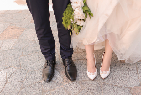 Legs of beautiful wedding couple outdoors 스톡 콘텐츠