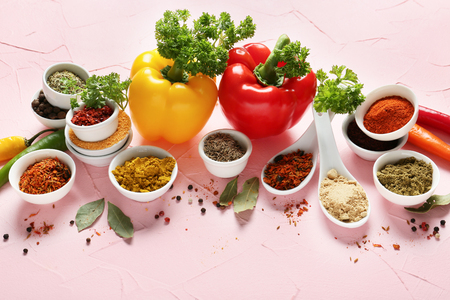 Composition with different spices on color background Фото со стока