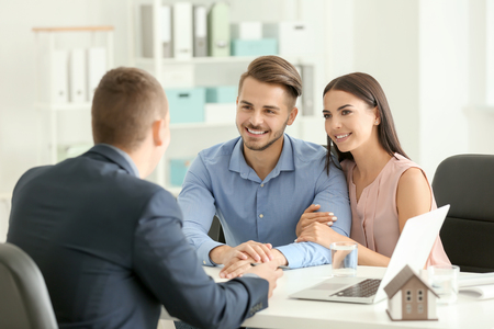 Real estate agent working with clients in office
