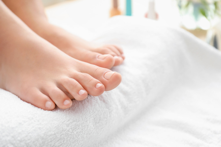 Young woman after getting professional pedicure in beauty salon, closeup