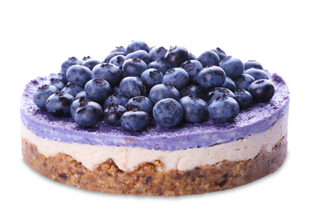 Delicious cheesecake with blueberries on white background