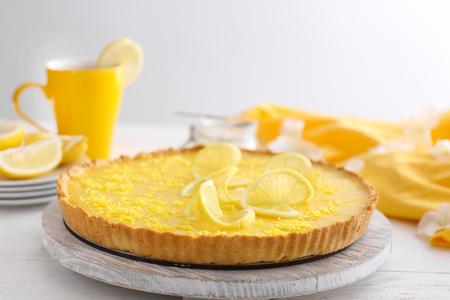 Tasty lemon pie on table