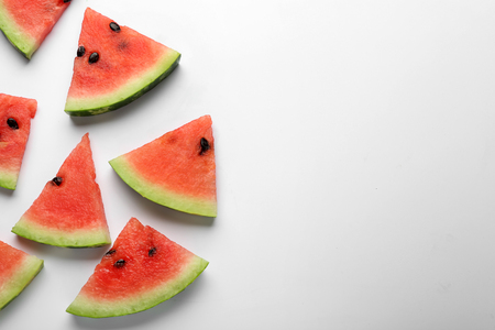 Delicious cut watermelon on white background