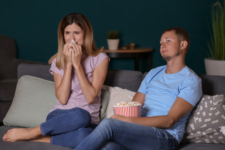 Couple watching soap opera in evening