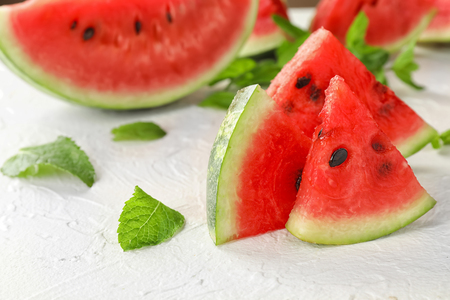 Sweet watermelon slices on white table