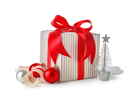Christmas gift box and decorations on white background