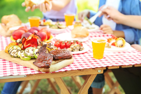 Family having picnic on summer day, closeup Standard-Bild