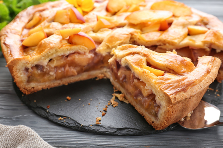 Tasty homemade peach pie on wooden table, closeup Stock fotó