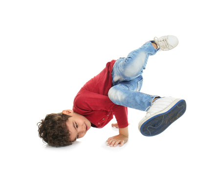 Sportive little boy on white background Фото со стока