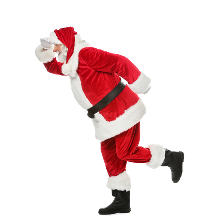 Running Santa Claus on white background