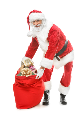 Portrait of Santa Claus with bag full of gifts on white background