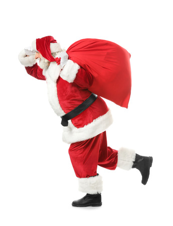 Running Santa Claus with bag full of gifts on white background