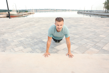Sporty young man training outdoors