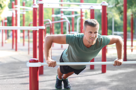 Sporty young man training on athletic field outdoors Foto de archivo