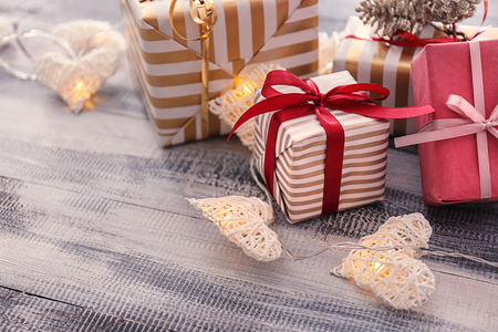 Beautiful Christmas gift boxes with decorations on wooden table