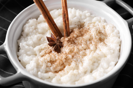 Delicious rice pudding with cinnamon and anise in casserole, closeup Stock Photo